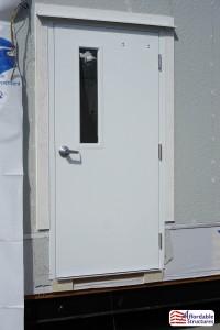 Steel exterior door with view block